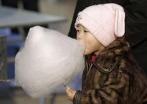 A Child Eat Cotton Candy